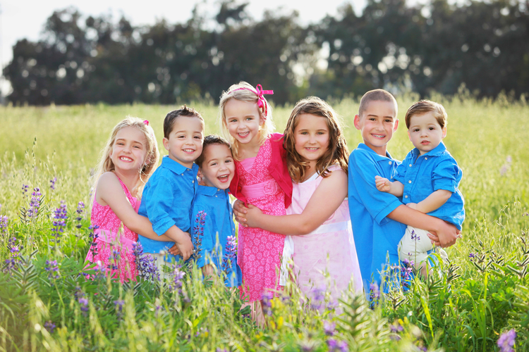 Beautiful young children outdoors in the flowers