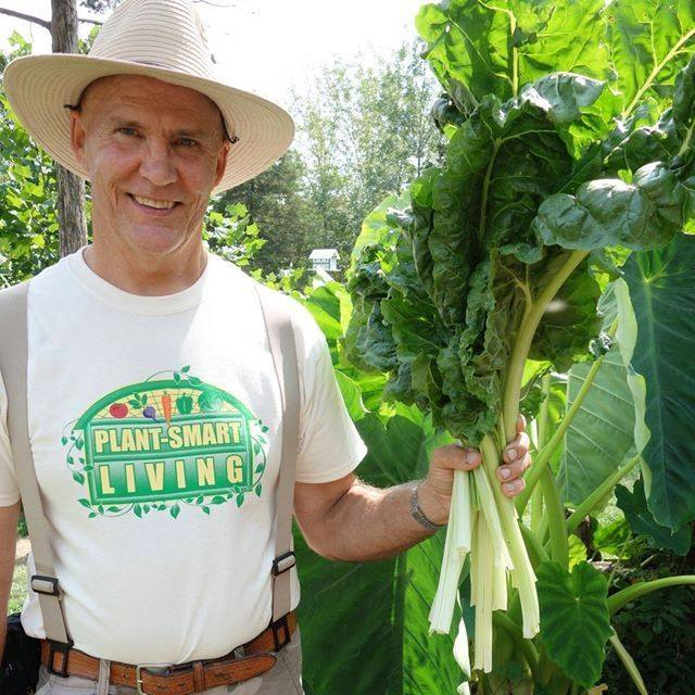 Farmer Fred with some fresh greens from the garden!
