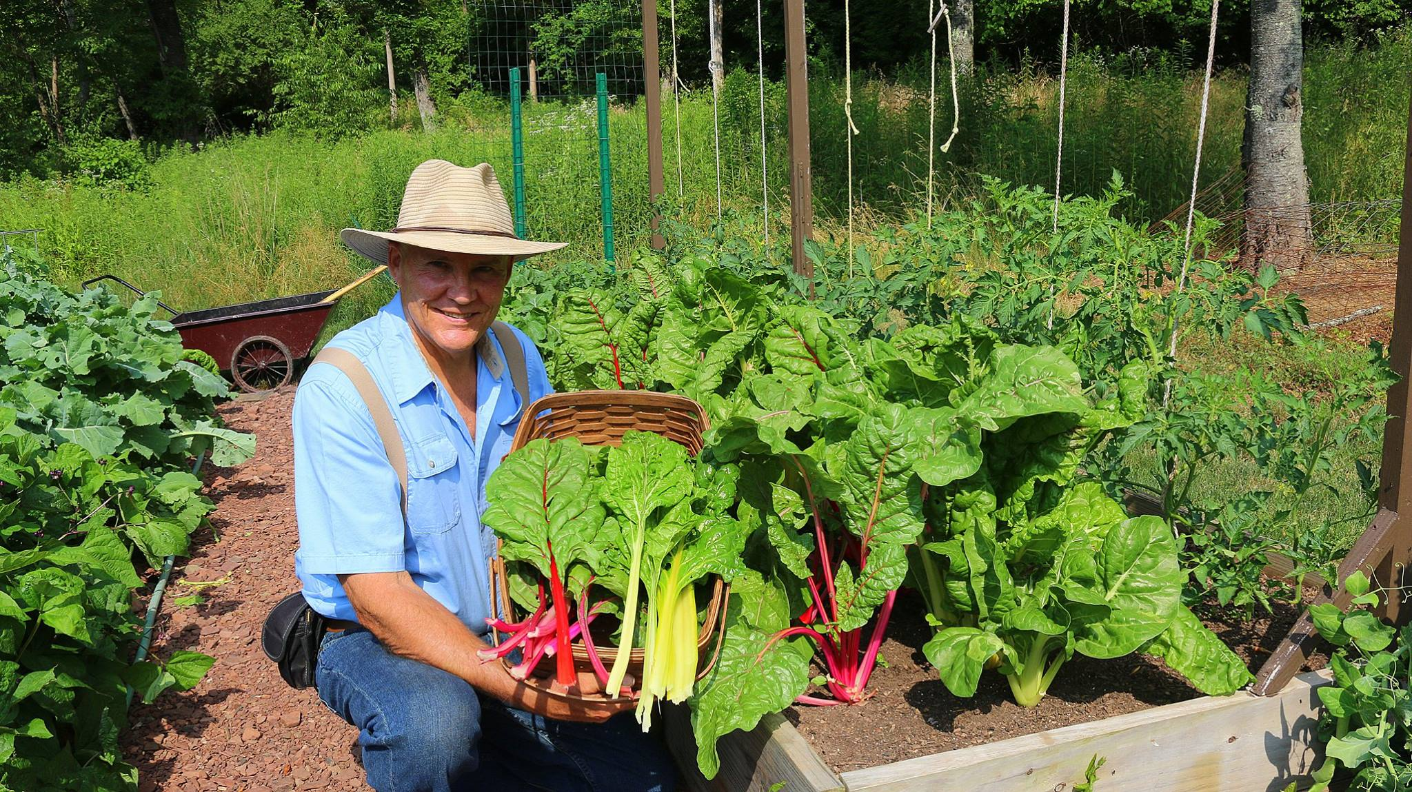 Farmer Fred reaping some of the harvest from his backyard garden!