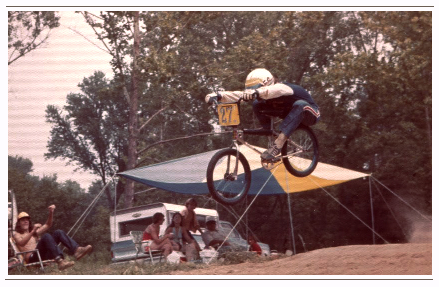 At a track in Collinsville, IL, Brad styles with a full lay-back style jump on his Mongoose bike