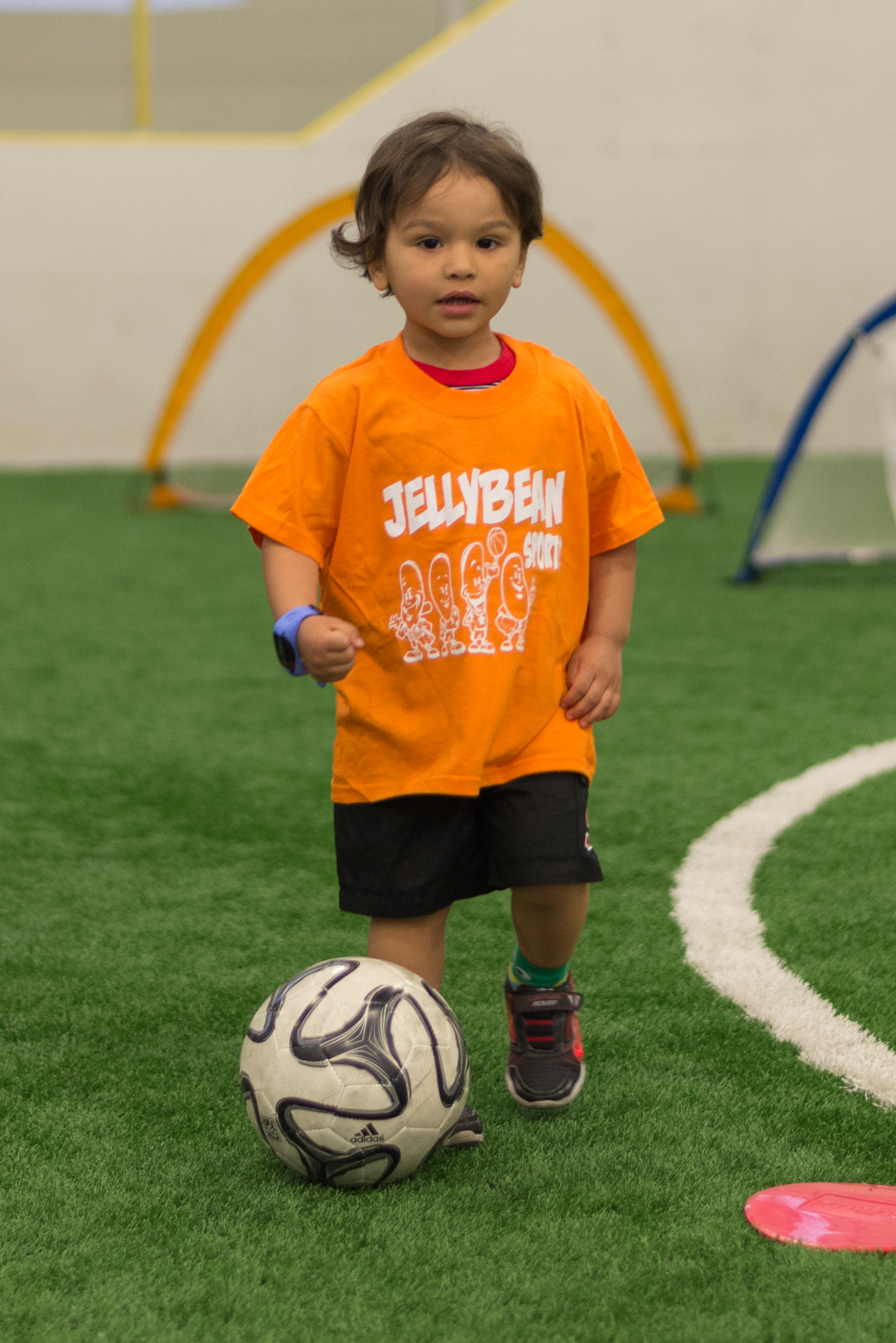boy dribbles soccer ball.jpg