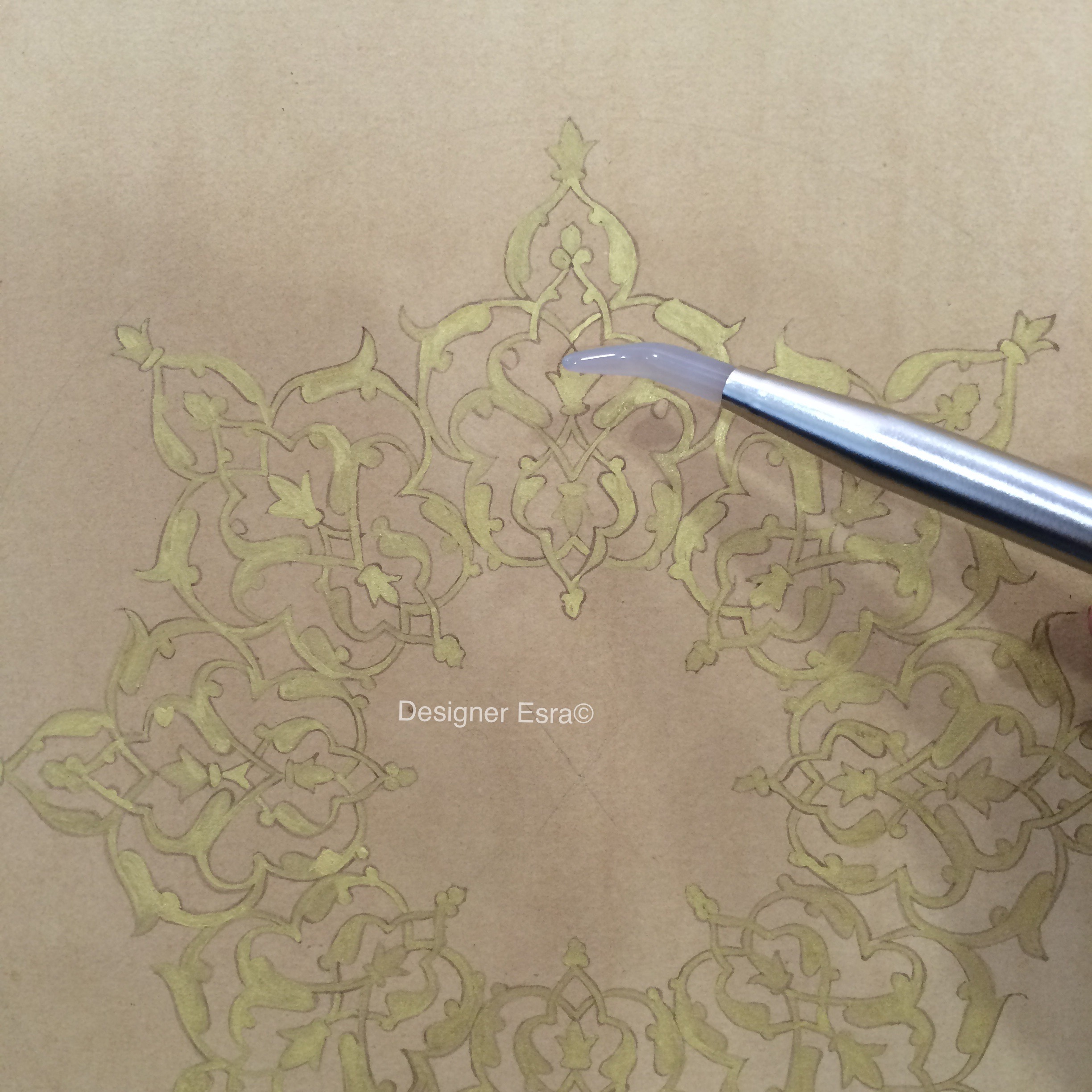 Painting with gold and burnishing it