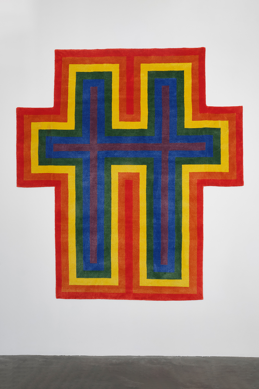 "Jonathan Horowitz  Rainbow Cross for Two, 2018  79"" x 86.5""  Hand knotted wool & silk"