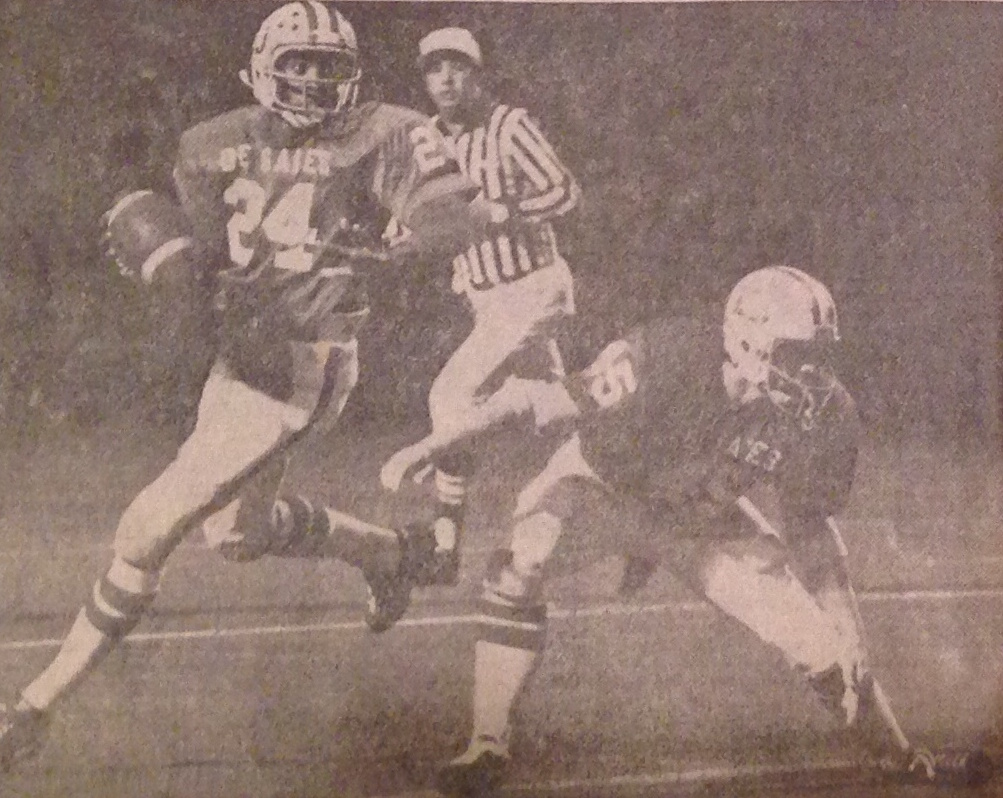Junior quarterback Eric Holleman (24) rolls out with fullback John Lawson (45) providing the protection