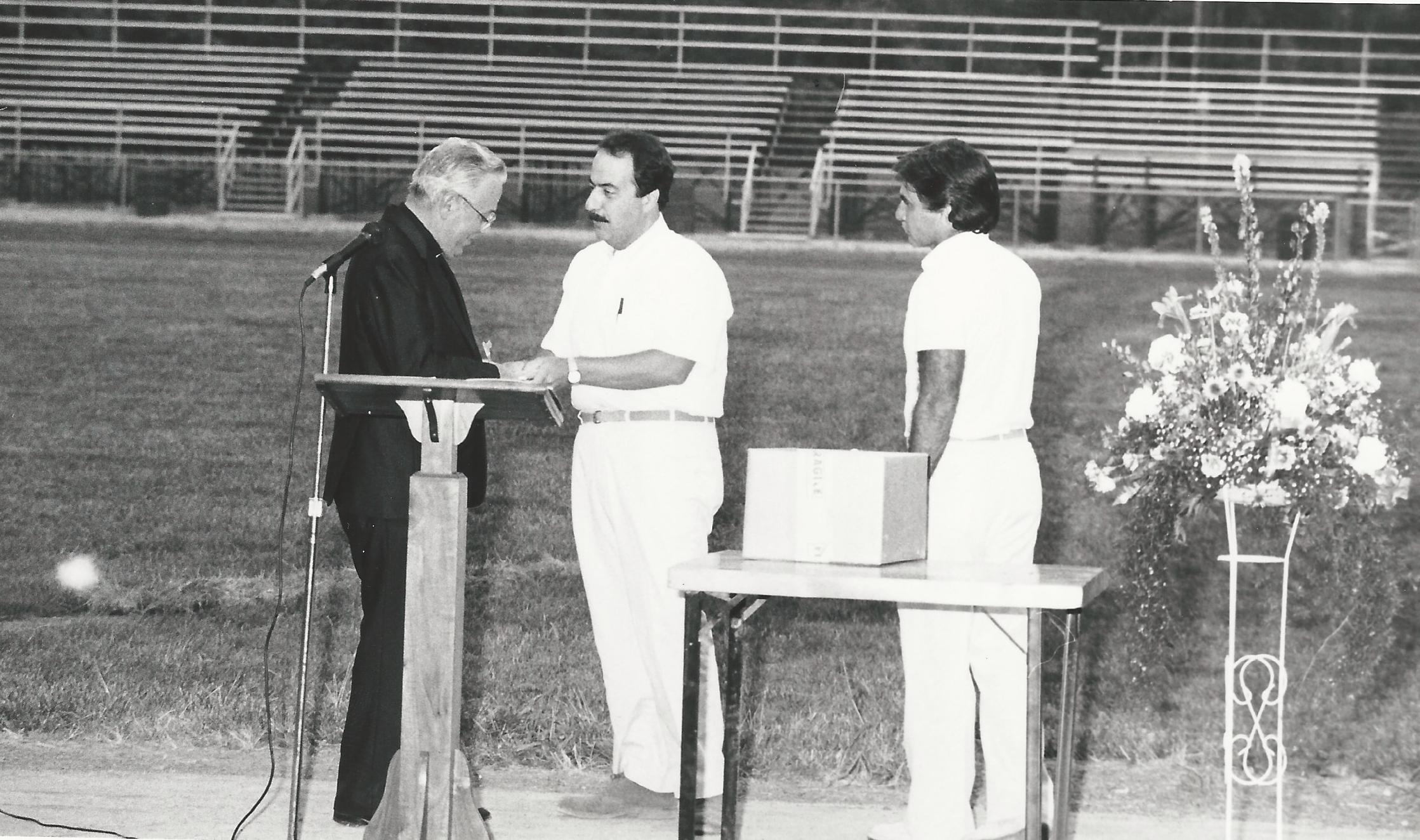 Former principal Msgr. James Berendt, principal Pat Rossetti and Athletic Director Bob Triano