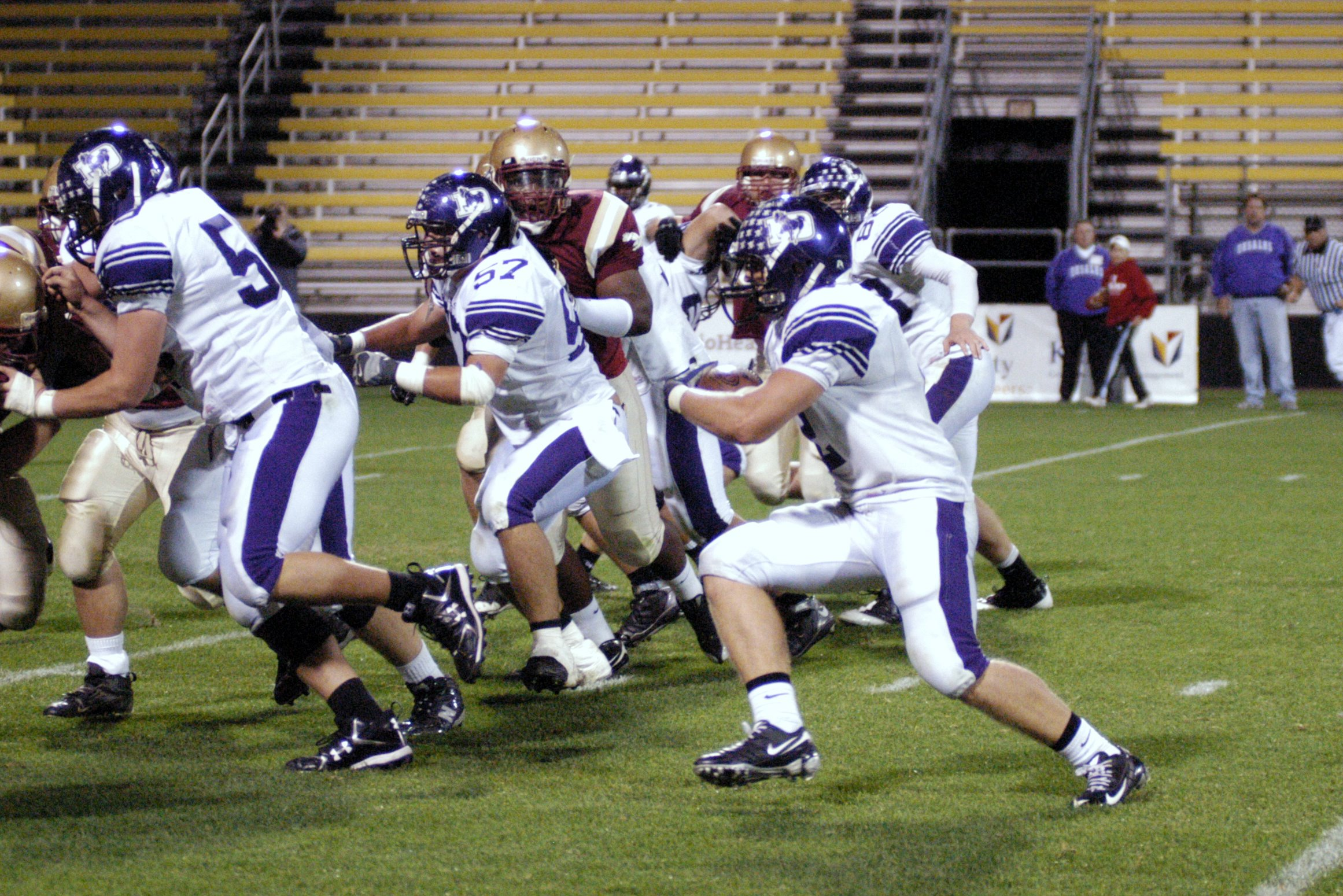 Jackson, pictured far left, leads the way for Josh Kusan in the 2008 Watterson game at Crew Stadium