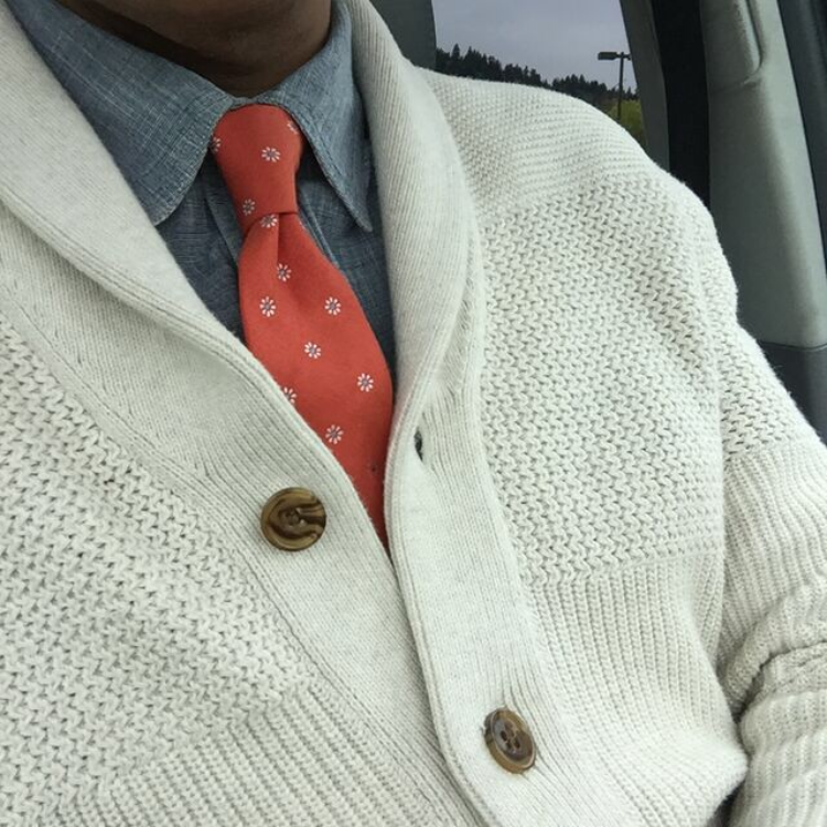 Bruce up close sweater and tie.png