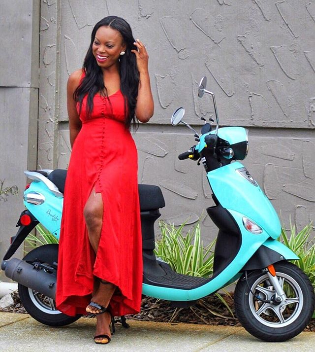 A girl with her scooter in her red dress and heels. One of the best of part of my weekend is riding this little beauty. #thoughtsoftheday life is short, time is fast. There is absolutely no replay, no rewind. So enjoy every moment as it comes. Bisous mes amours! Dress @mickaas_official #summerday #uptownwithmickaa