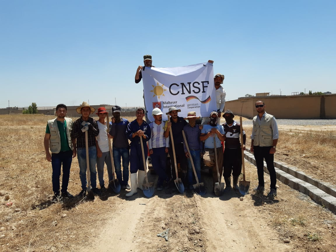 CNSF team along with the workers after finishing the sewage network project.