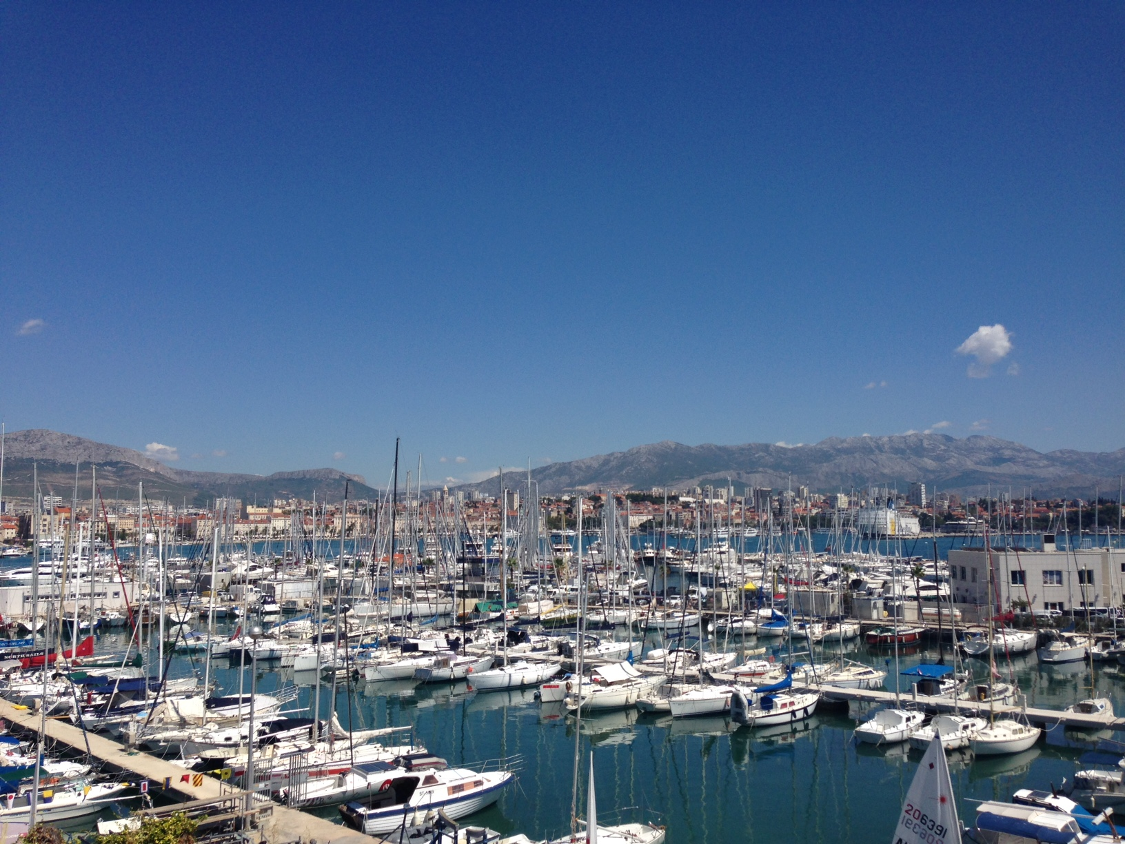 The view from the sailing club marina looking over to the city of Split and the mountains in the distance.