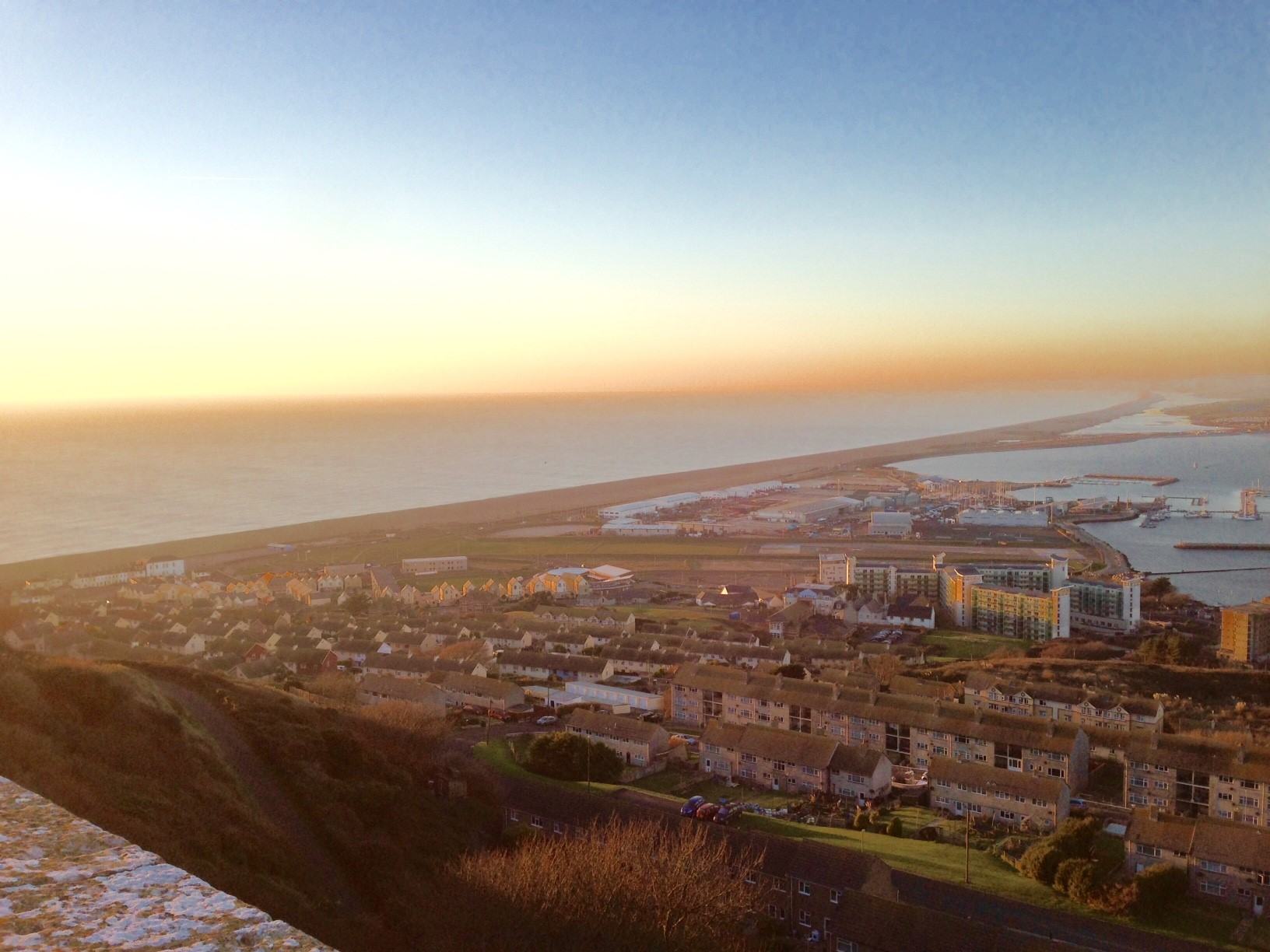 The view from the top of Portland Hill overlooking Chesil Beach and Weymouth in the distance.