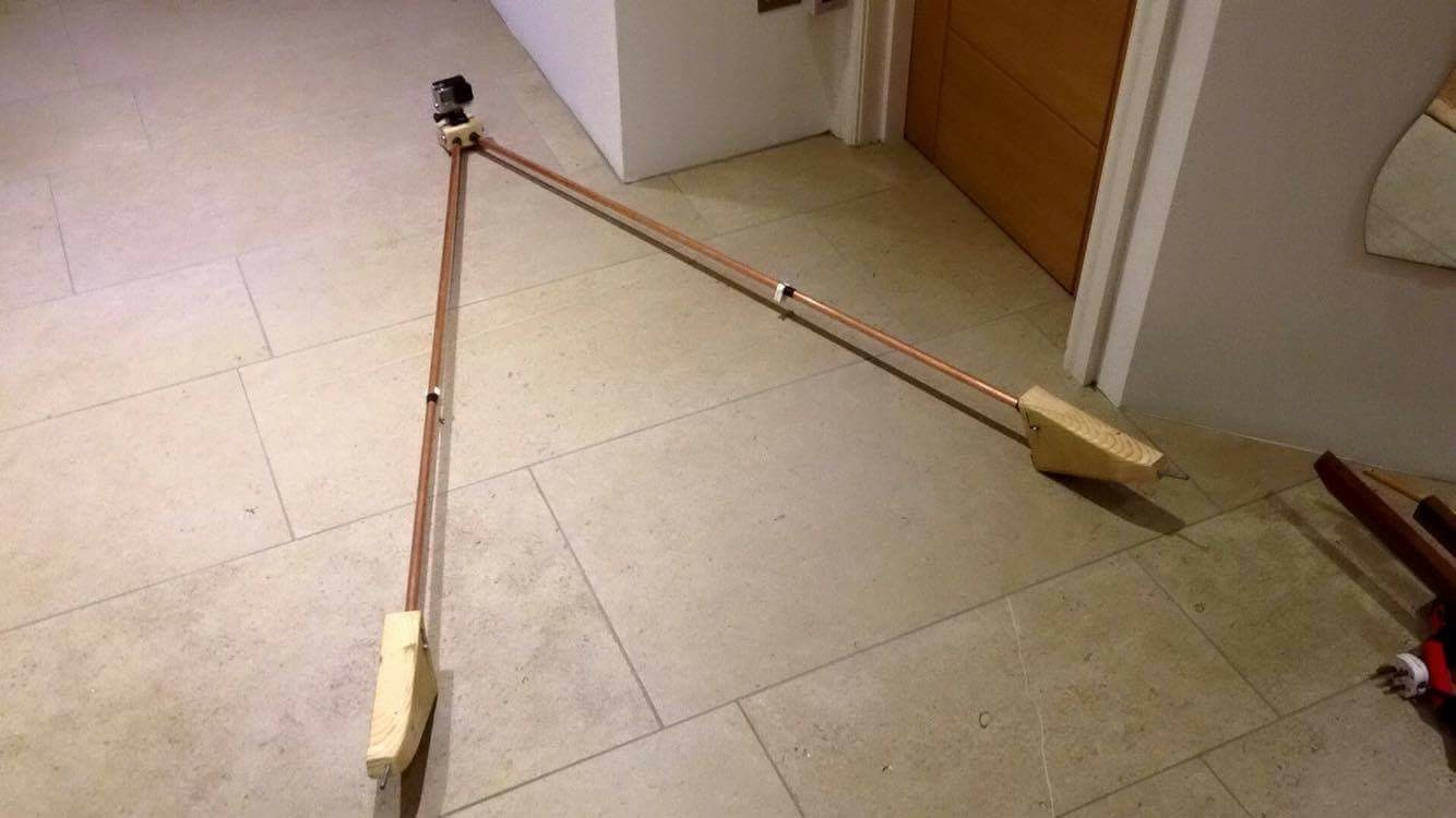 My home made Laser GoPro mount -made of a carved wooden base with copper tubing.