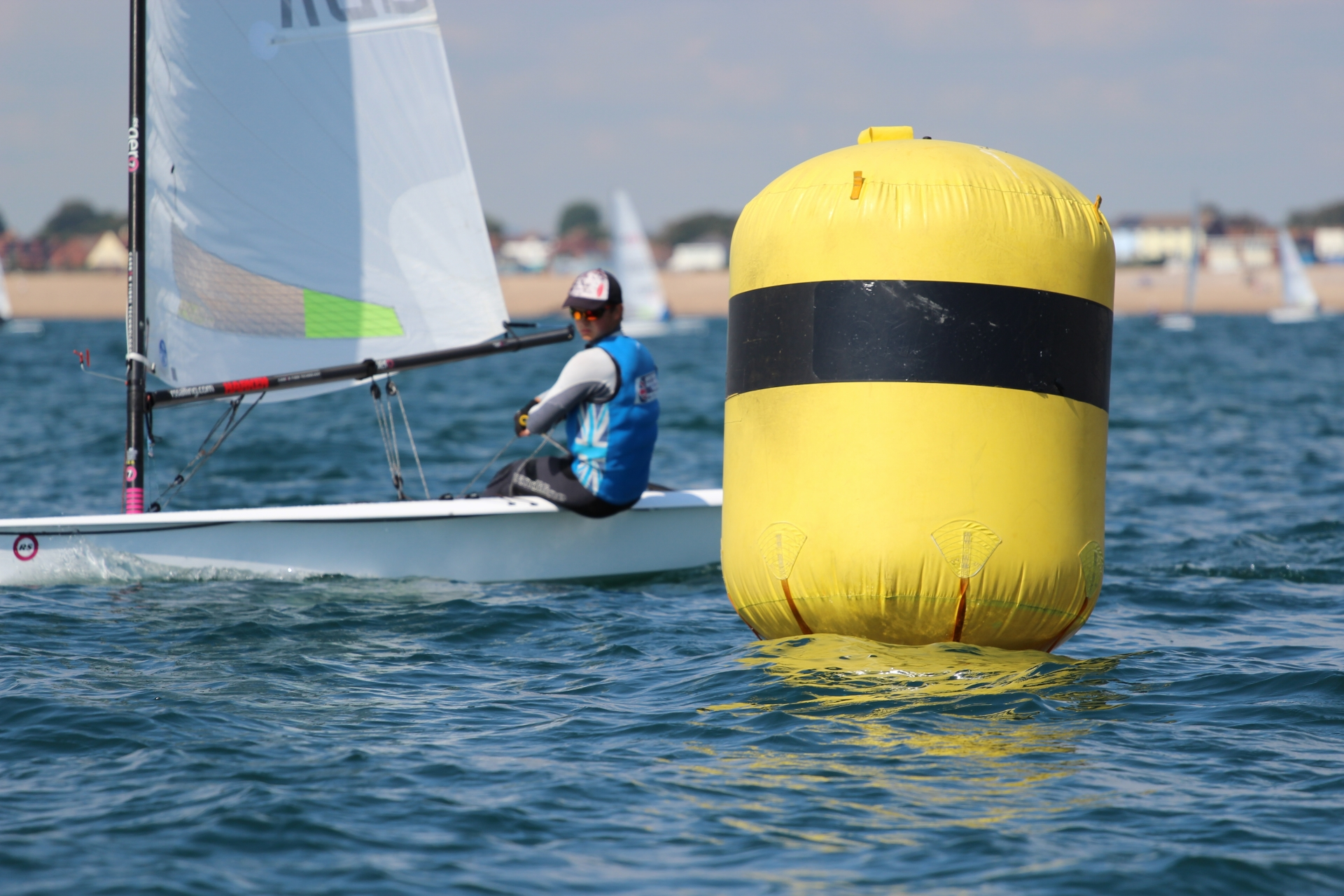 Here you can see me really looking upwind trying to find where the most wind is, where it will be and how I can best make use of it as I approach the windward mark.