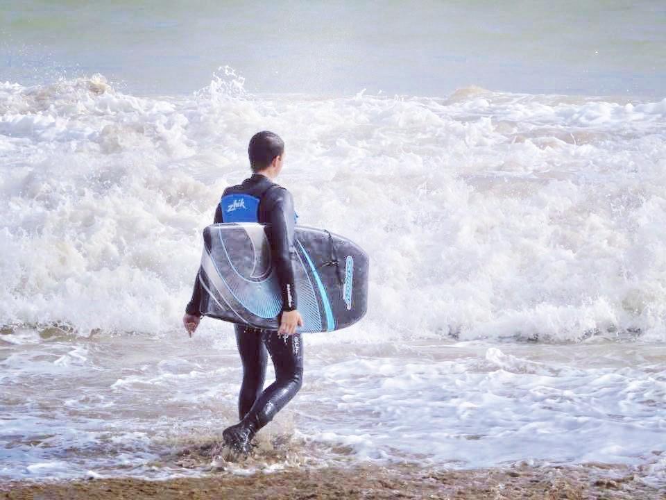 Bodyboarding in waves off Swanage Beach.