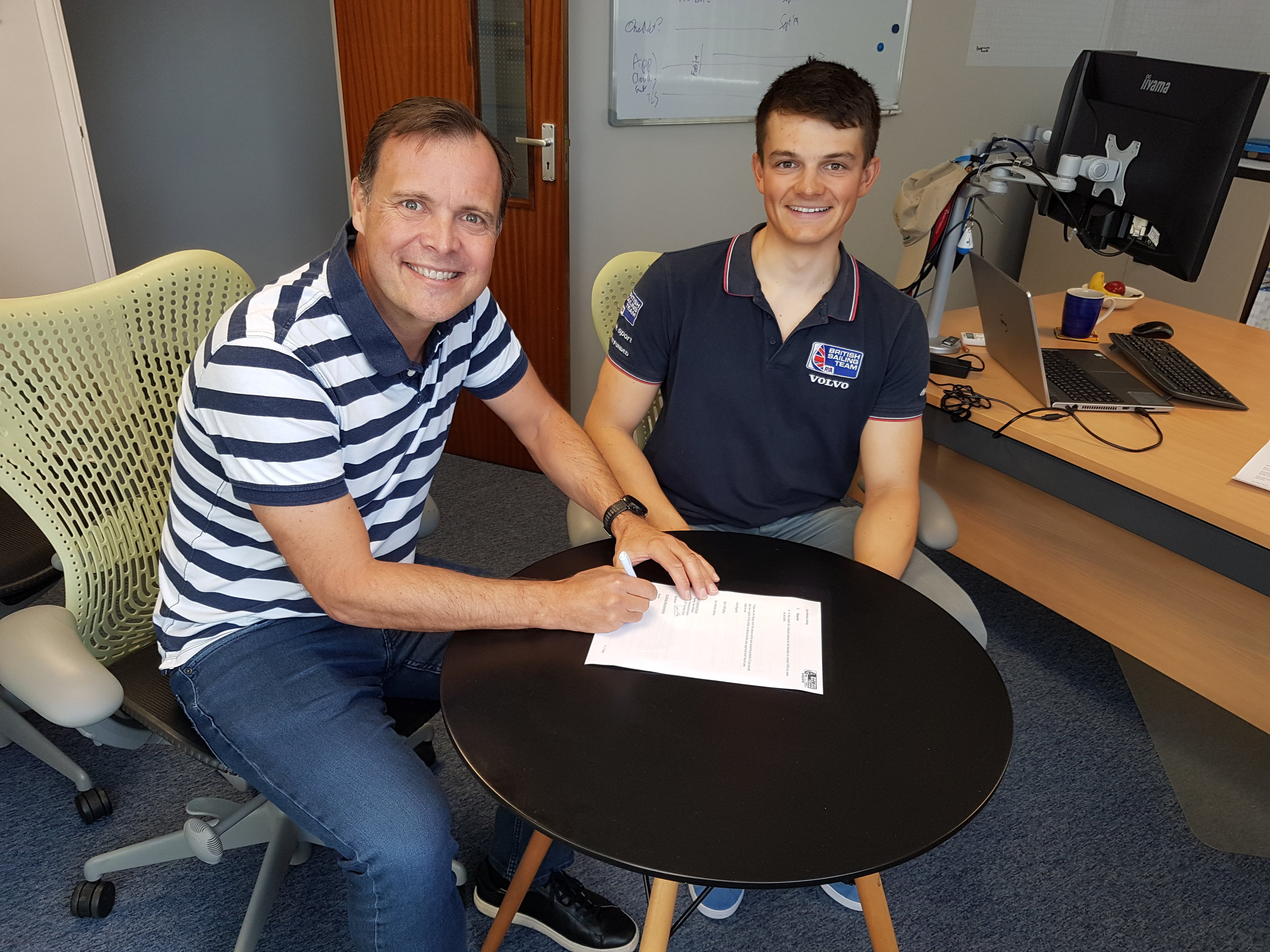 Signing the contract with CEO Phil Whitehurst.