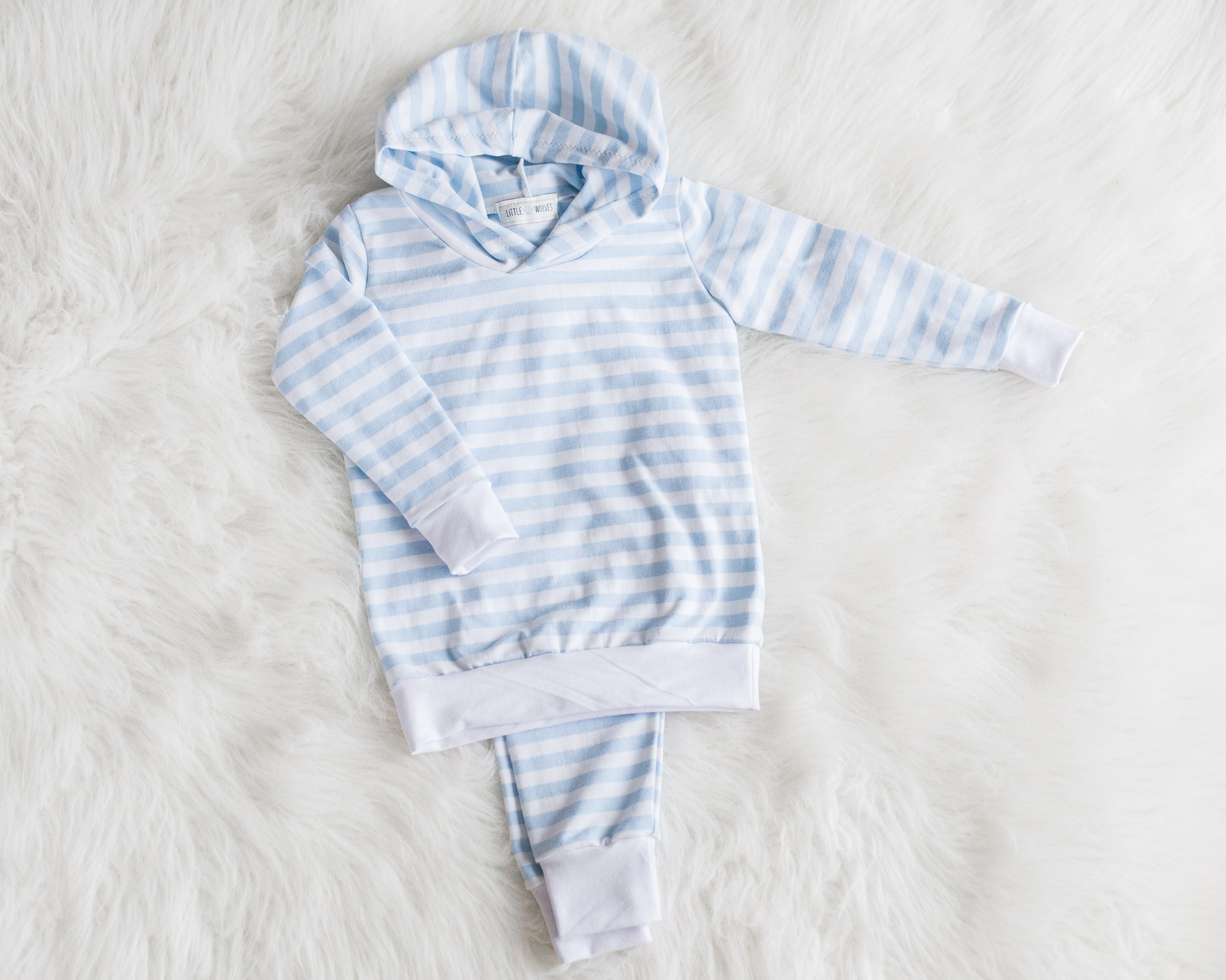 LITTLE WOLVES - Little Wolves is handmade children's apparel using ultra soft and stretchy bamboo fabric and organic cotton. Rompers, cuff pants and hoodies are stylish but most importantly comfortable.