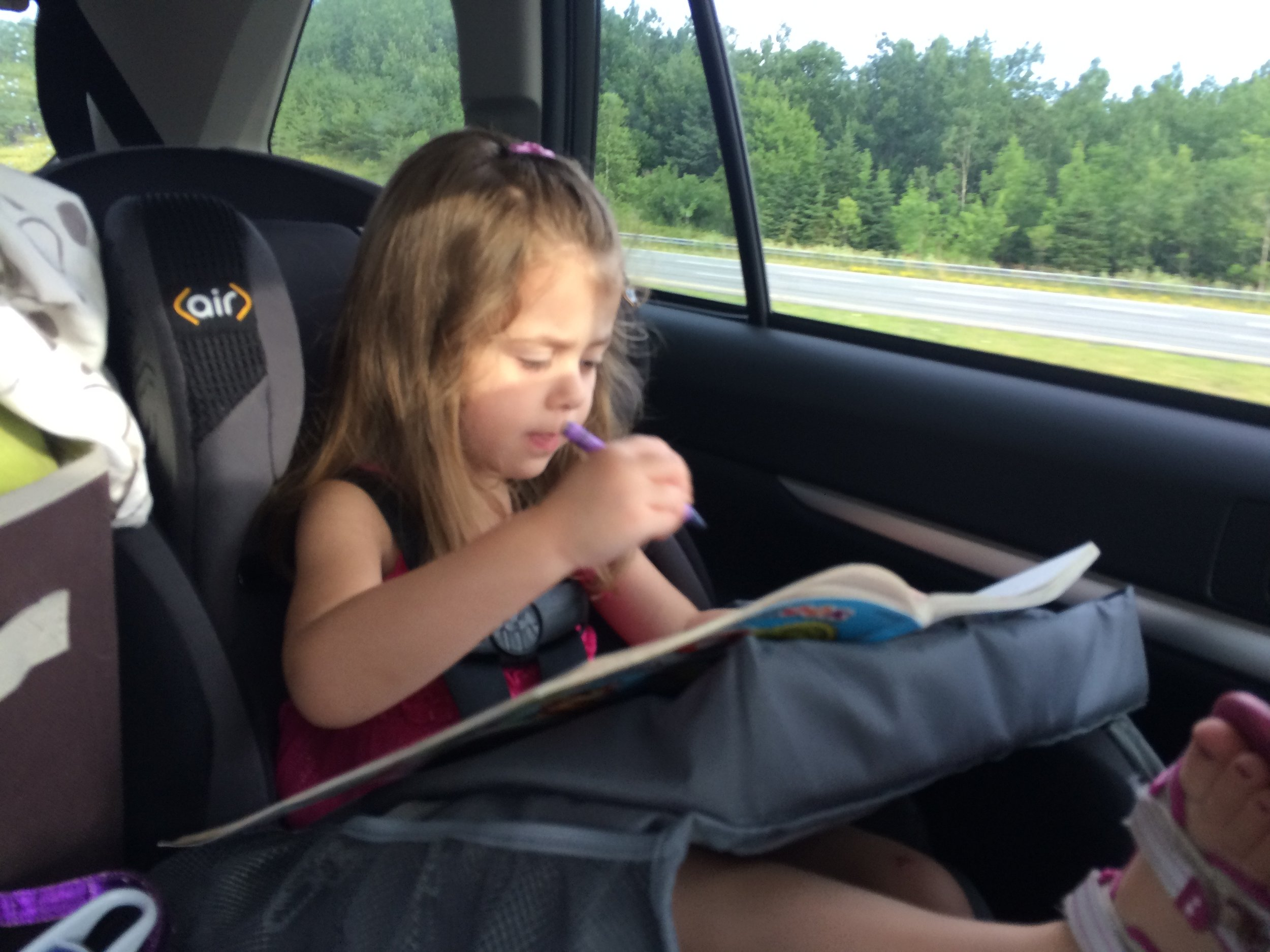 Miss M at age 4 on our way to New Hampshire