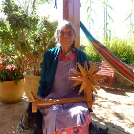artisan with her spinning wheel
