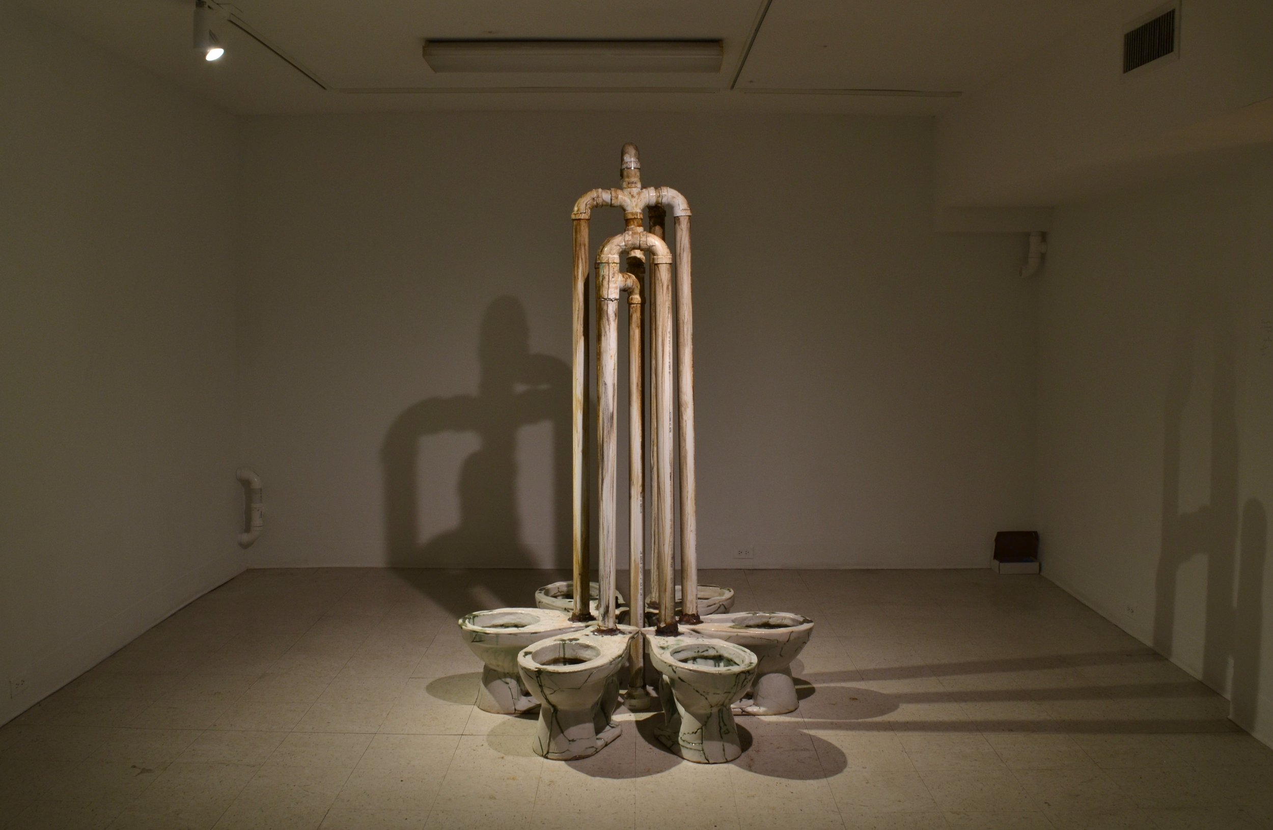 Fountain    ^10 stoneware, copper and iron oxides, glaze, PVC, paint, lead solder, water  84 x 60 x 60