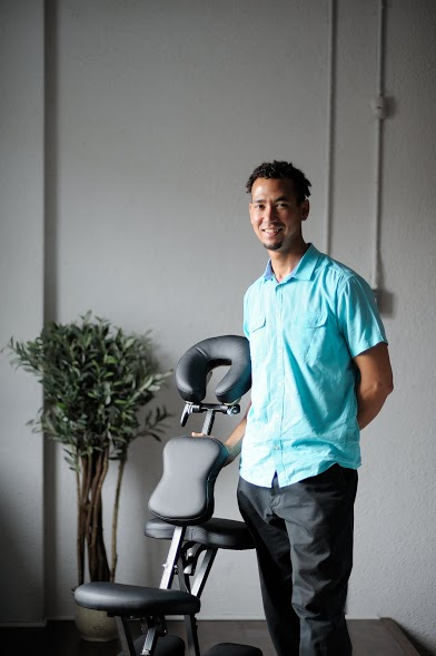 Jesse-RMT and his specialized portable chair where employee's enjoy the great benefits of massage at work. 15 minutes of peace and paradise.
