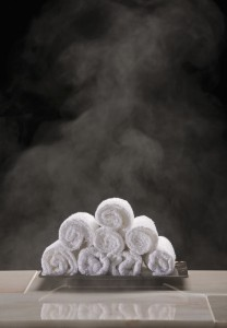 rolled-up-towels-products-spa-white-body-care-34236792.jpg