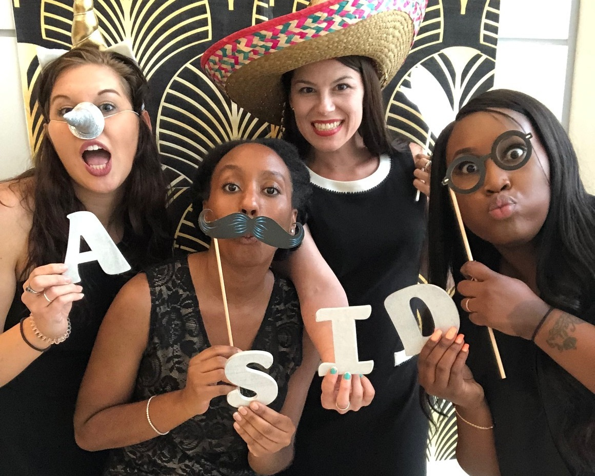 ASID STUDENT MEMBERS AT THE PHOTO BOOTH FOR THE SUMMER MIXER