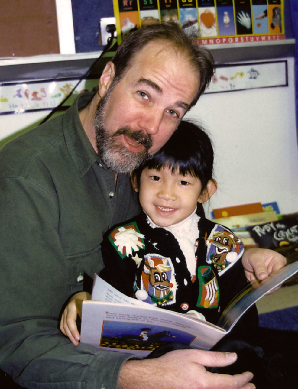 Tom with daughter, Tian (and hair), at a parent read-aloud session, NYC PS 234.