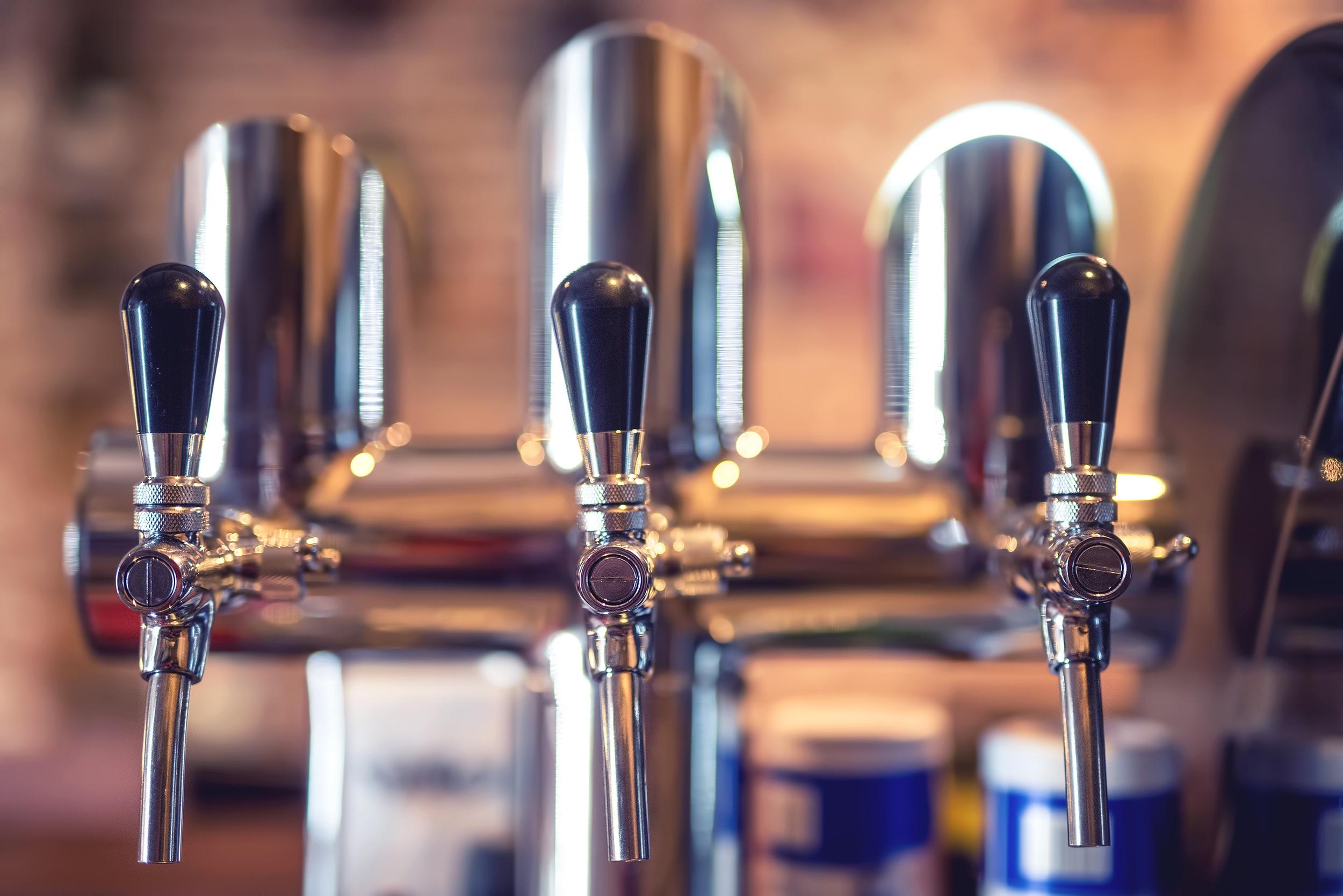 bigstock-Beer-Tap-At-Restaurant-Bar-Or-115331057-2.jpg
