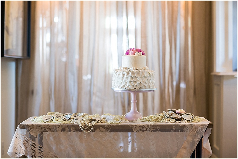 grace and serendipity, ashley victoria photography, fiore  - the lacy oyster - layered wedding cake with pink stand, flower topper, pearls and oysters, with pink lace tablecloth