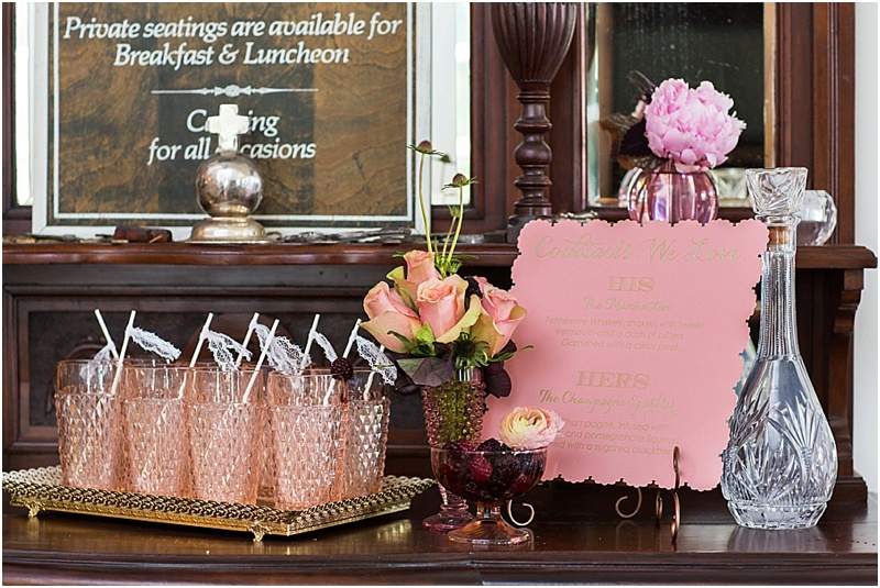 grace and serendipity, fiore, ashley victoria photography  - the lacy oyster - pensacola wedding styled shoot - cocktail area with pink and gold menu, pink roses, peonies, vintage pink glasses, lace drink flags, gold mirror as tray