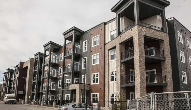GRIESBACH CONDOS  – Hardiplank/Hardie Trim/Aluminum Drip Cap and matching fasteners – powder coated in two custom match General Paint colors