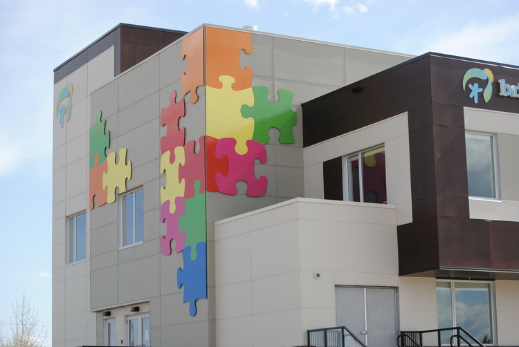 DAYCARE - PUZZLE PIECES  - steel powder coated in 5 custom primary colours to represent the brightness of the Rainbow for Bright Path Daycare.