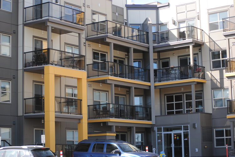 UPPER WINDERMERE CONDO COMPLEX  – Hardie Lap, Hardie Trims, Drip Caps, Steel Shutters and EZ Trim all coated to highlight Alpacca (a custom General Paint colour).