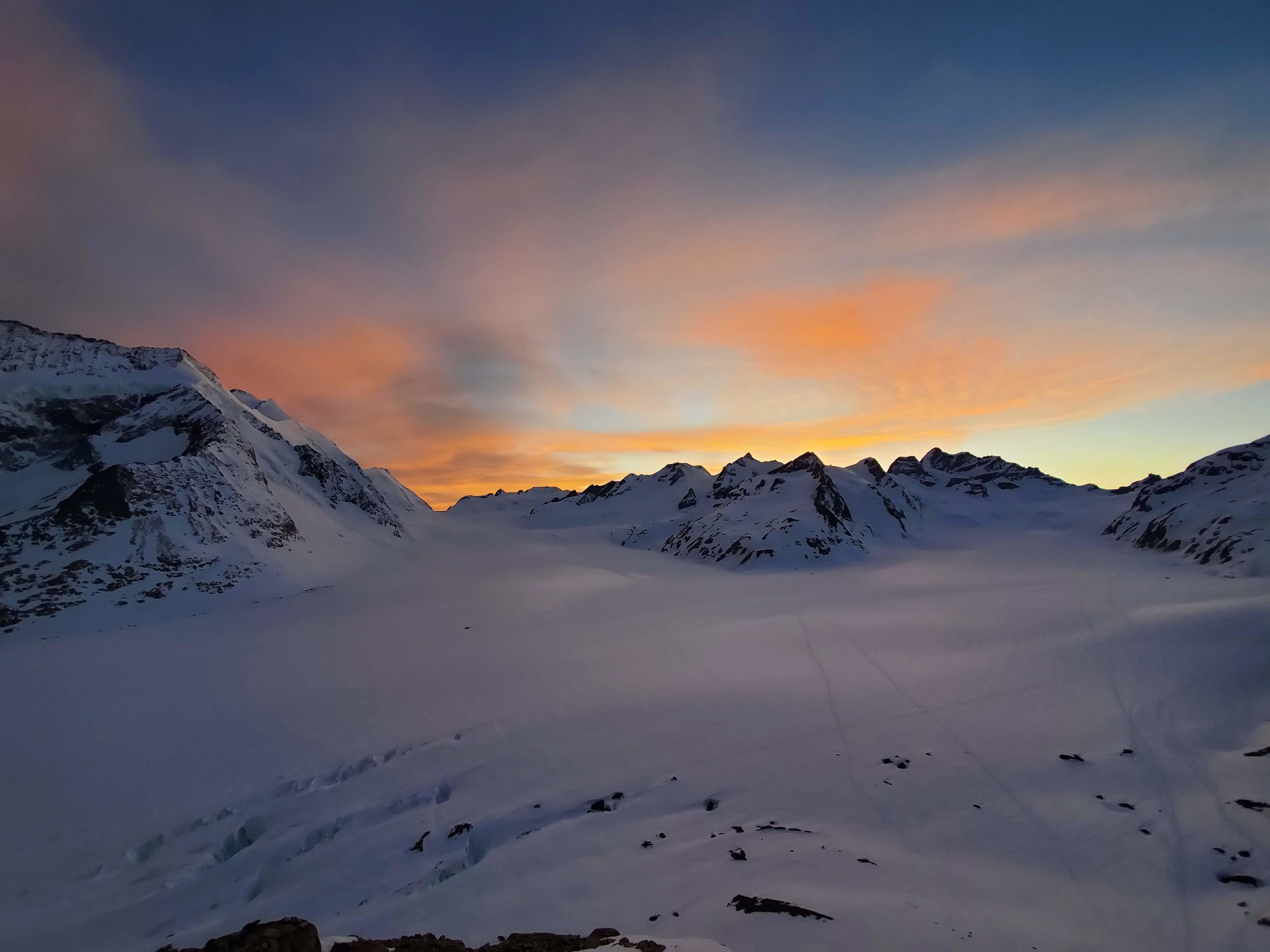 Sunset over the Bernese Alps from the deck of the hut. Early to early to rise for the next day's adventures.