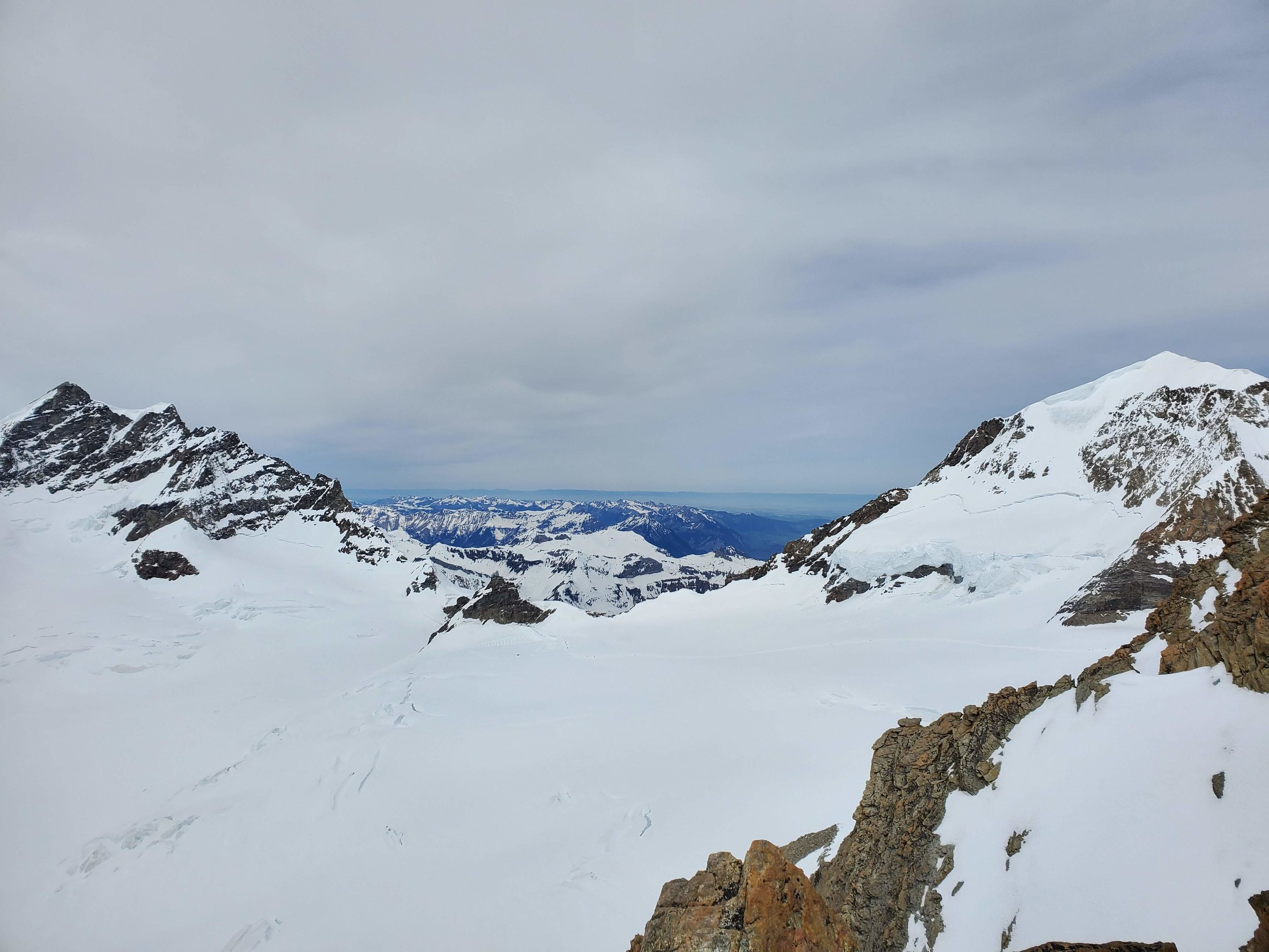 Looking back to the Jungfraujoch station (lower center) with the Junfrau (left) and the Mönch (right, top just cut off). On our last trip here we climbed the Mönch via the rock/snow ridge line in the right of this photo (and I was so terrified I swore I'd never come back haha (being a good climber means having a bad memory).