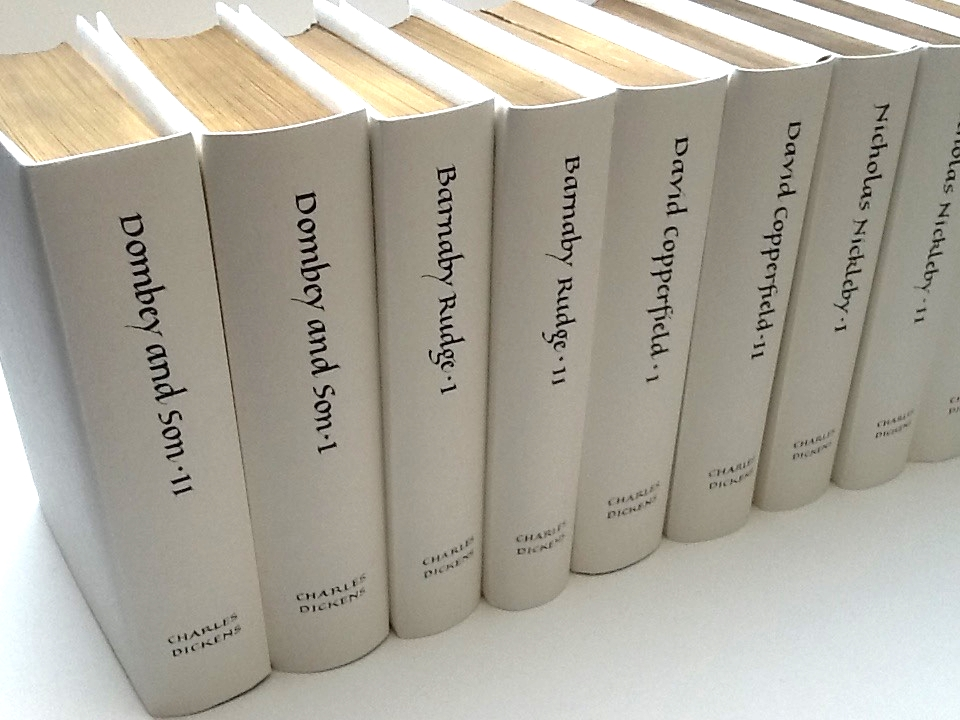 Covers for a book collection, made from handmade Indian rag paper and titles written in black ink.