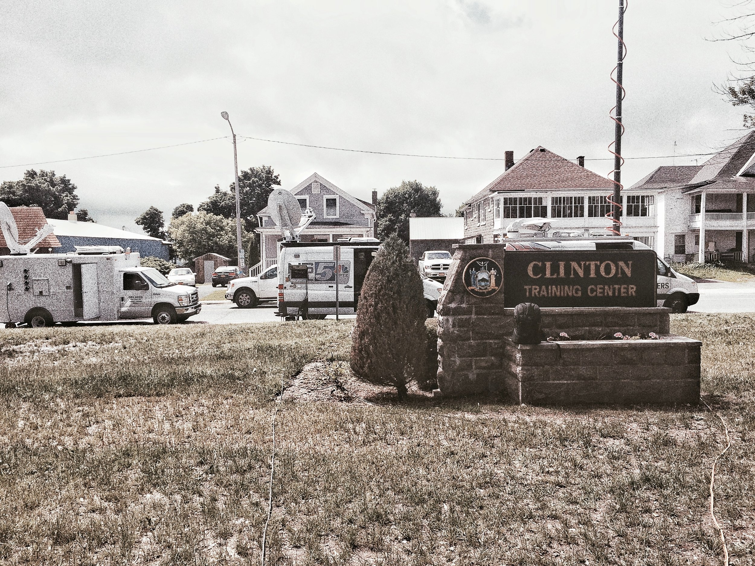 TV trucks line up in front of Clinton Correctional Facility for a press conference about the prison break. (Chelsia Rose Marcius/June 19, 2015)
