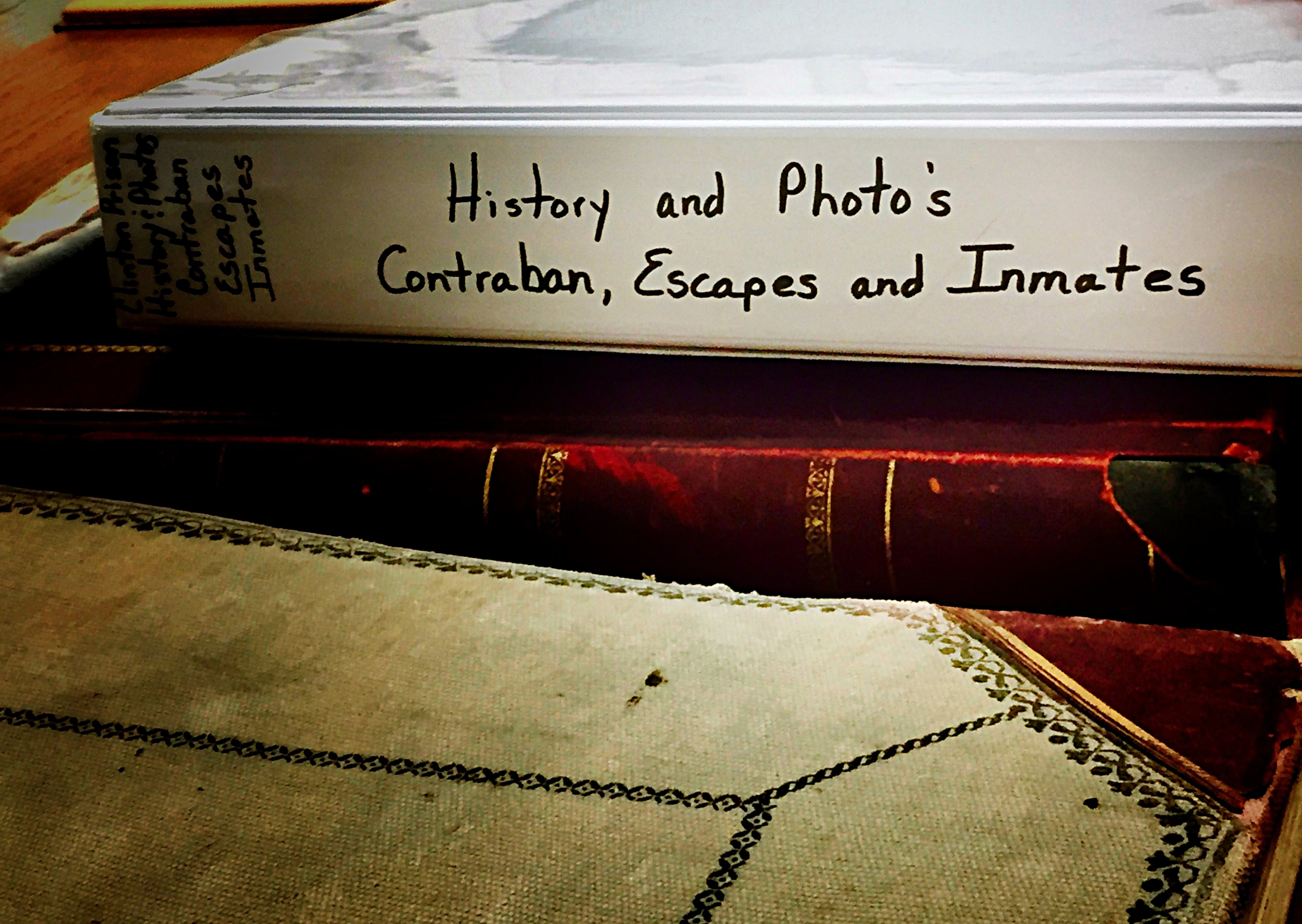 """A collection of documents on Clinton Prison escapes from the early 20th century, curated by historian Walter """"Pete"""" Light for the Museum at the Dannemora Free Library. (Chelsia Rose Marcius/August 14, 2016)"""