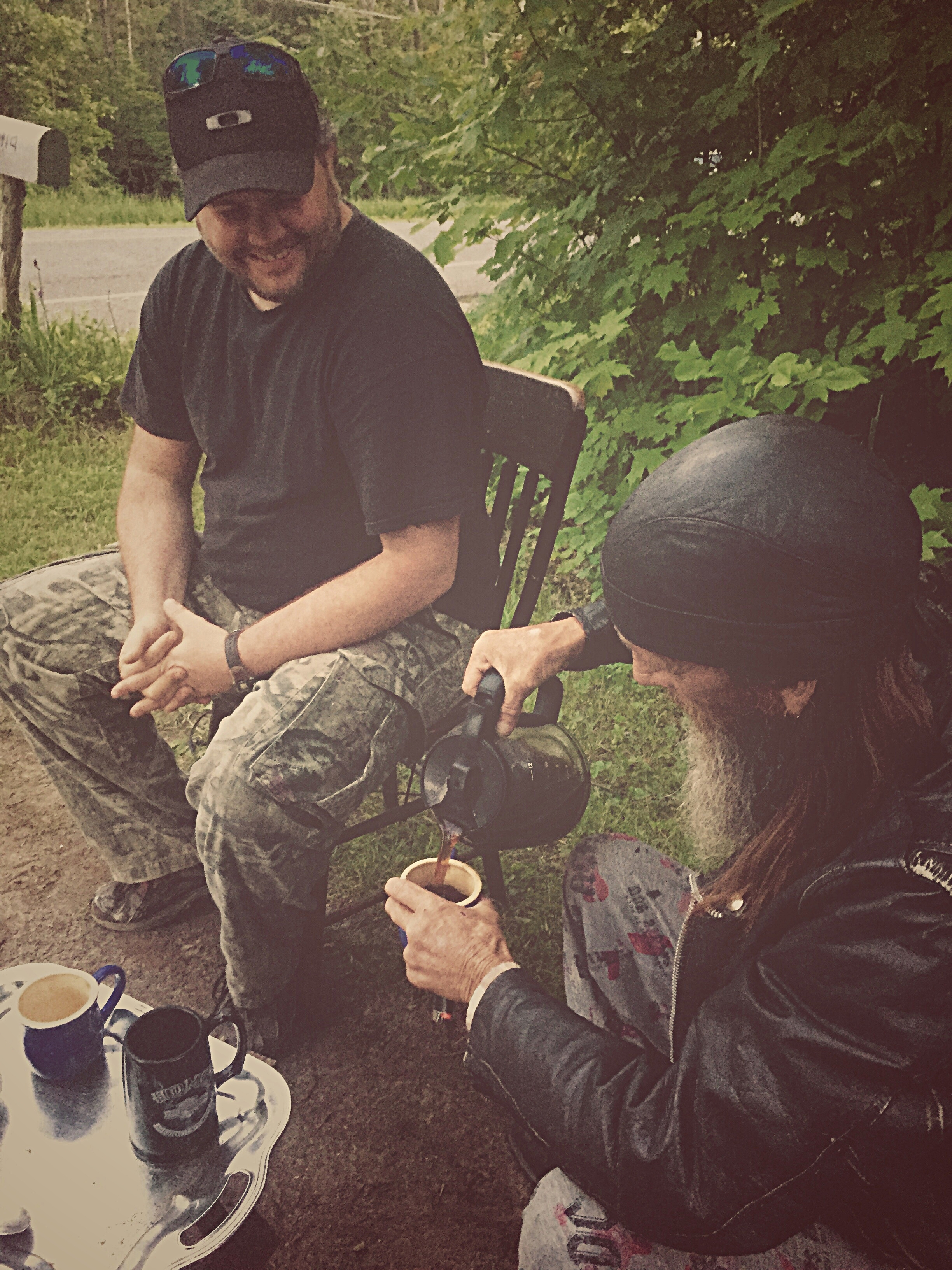"""Michael McCaffrey joins """"Slim"""" for a cup of coffee on the side of Fayetteville Road in Malone, N.Y. as state troopers descend on the area in search of David Sweat.  (Chelsia Rose Marcius/June 26, 2015)"""