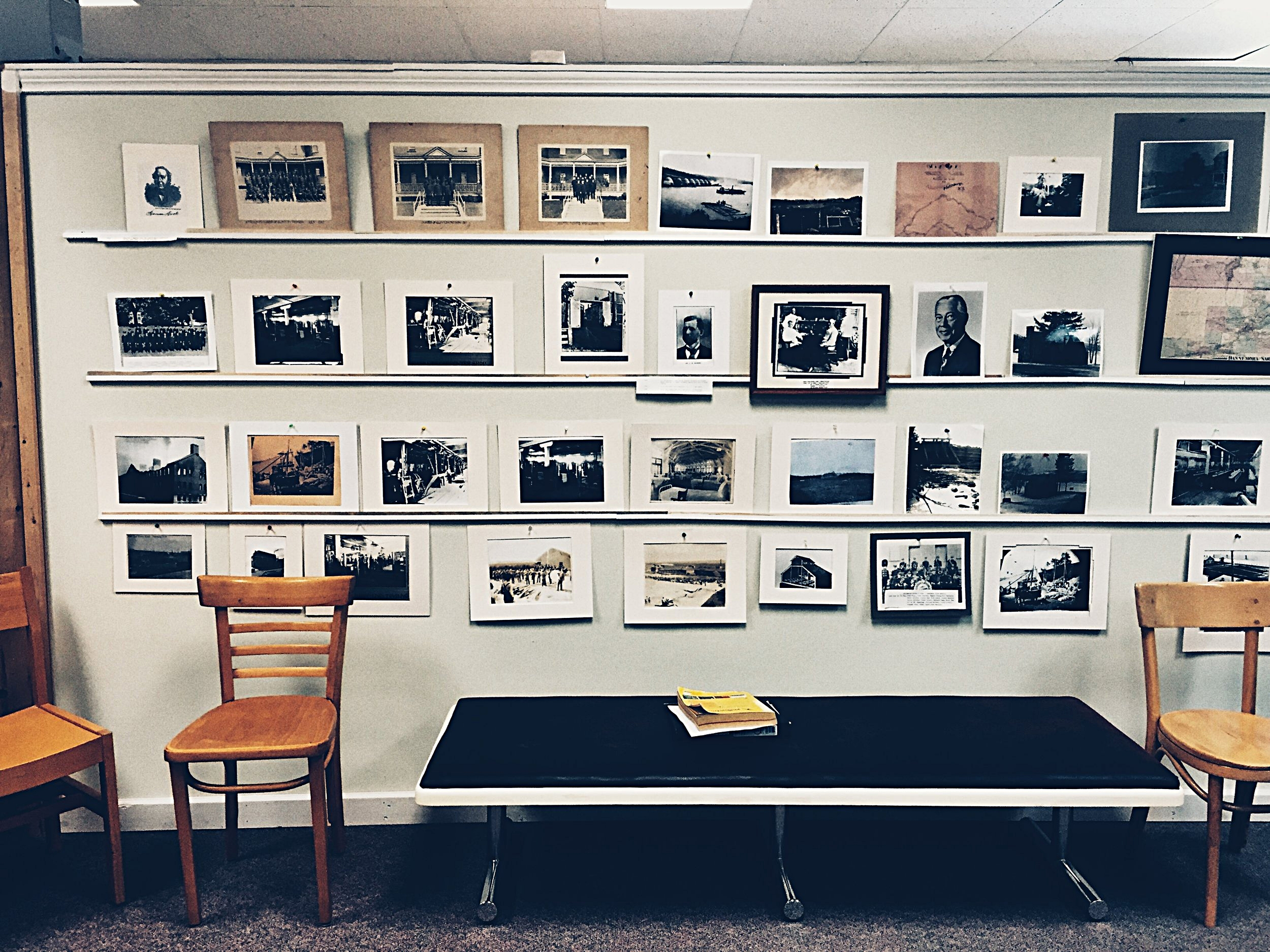 """Photographs of Dannemora and Clinton Prison, curated by historian Walter """"Pete"""" Light for the Museum at the Dannemora Free Library. (Chelsia Rose Marcius/August 14, 2016)"""