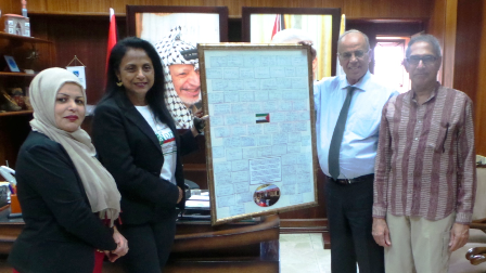 Delivering messages from Australia to the Mayor of Nablus (second from right).