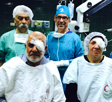 A highlight was operating on a husband and wife, one after the other on the same day, pictured here with Dr Anan Matar, the resident surgeon (left), and Dr Francis Nathan (right).
