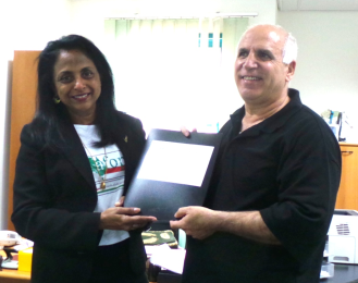 Delivering a folder of messages from Australia to the Chief Librarian at An-Najah University, Nablus.