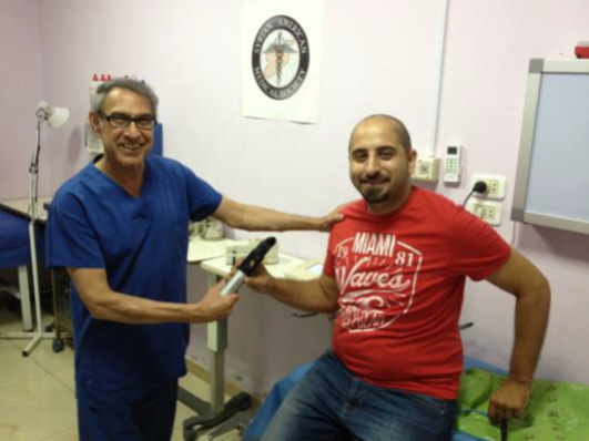 Dr Francis delivers the new piece of diagnostic equipment to Mahmoud of PCRF.