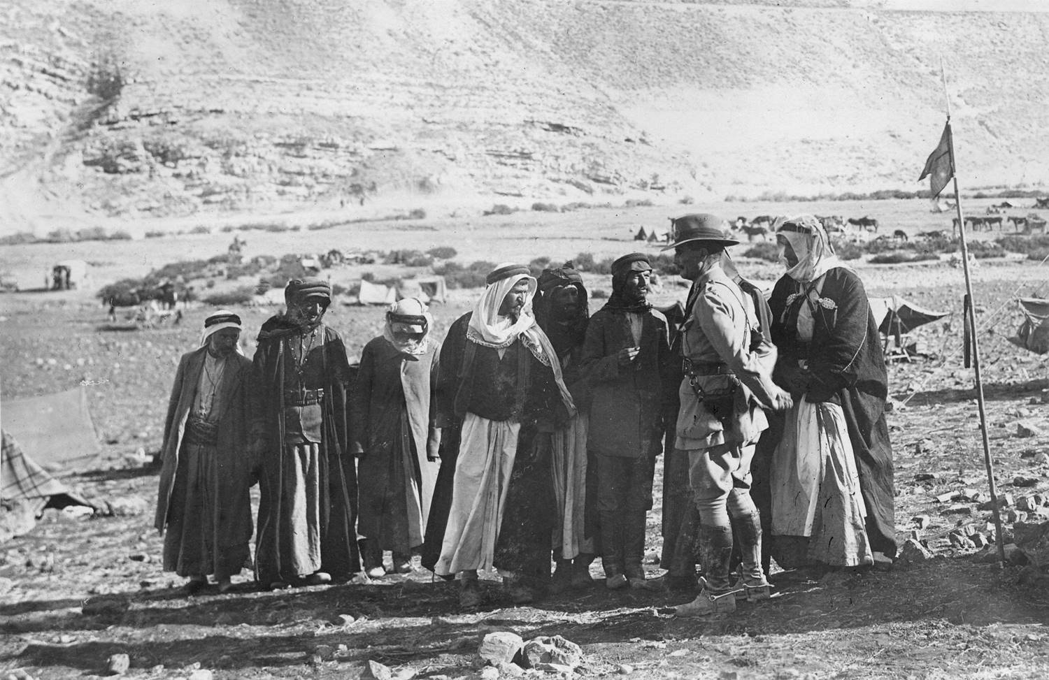 Australian solider talking with a group of Arabs in Palestine, 1918. [Photo with permission from State Library of South Australia, PRG280/1/15/1072.]