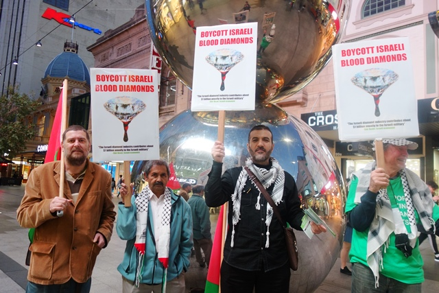 The AFOPA activists with their new placards in Rundle Mall, Adelaide, highlighting the Israeli diamond industry and its complicity with human rights abuses. Australia is chair of the 2017 Kimberley Process meetings this year.