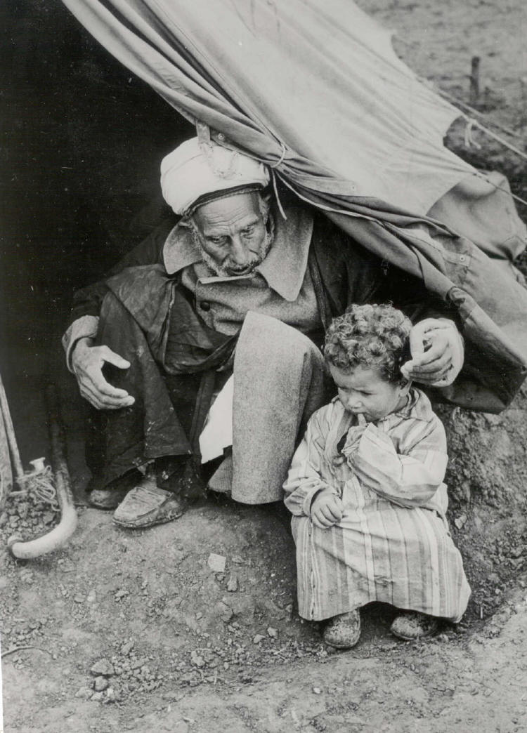 Old man and child in tent