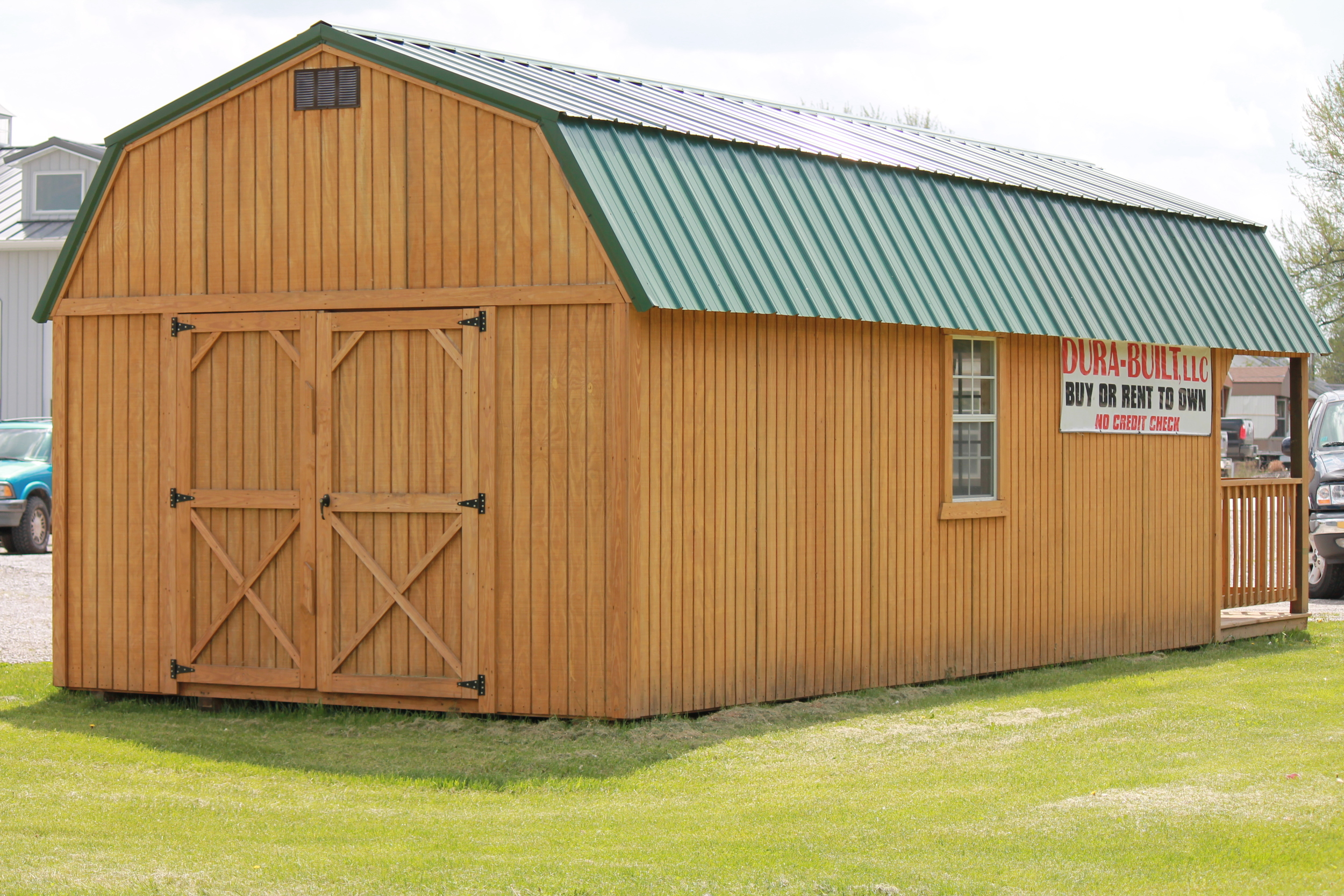 pressure treated lofted cabin with front porch.JPG