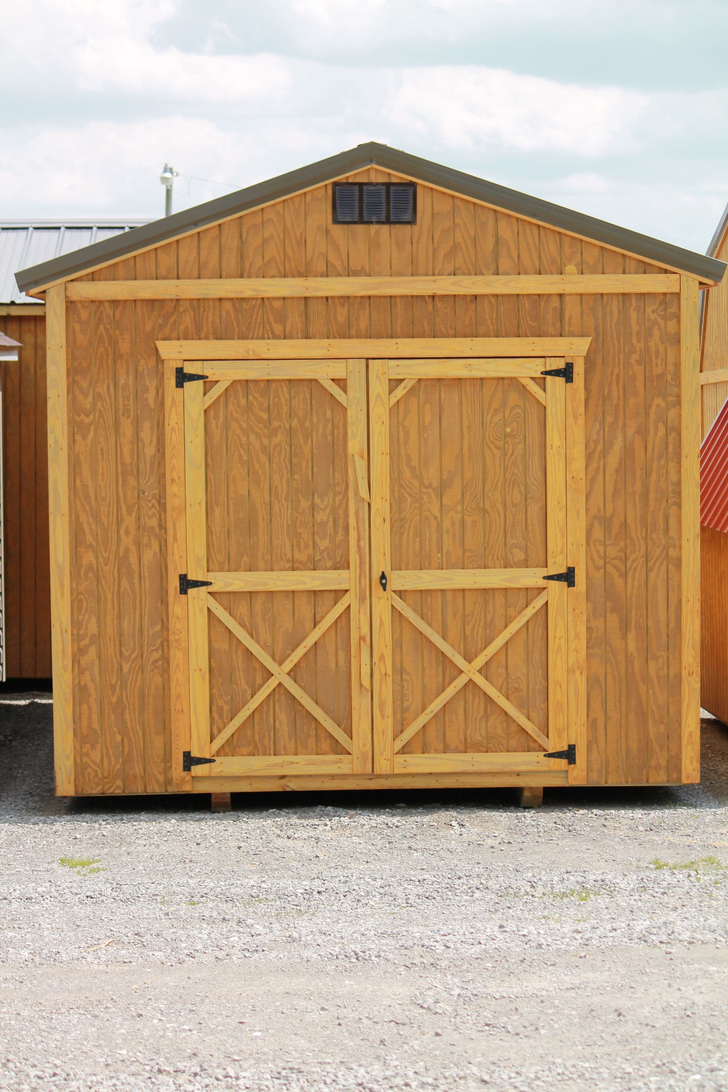 pressure treated utility shed with metal roof..JPG