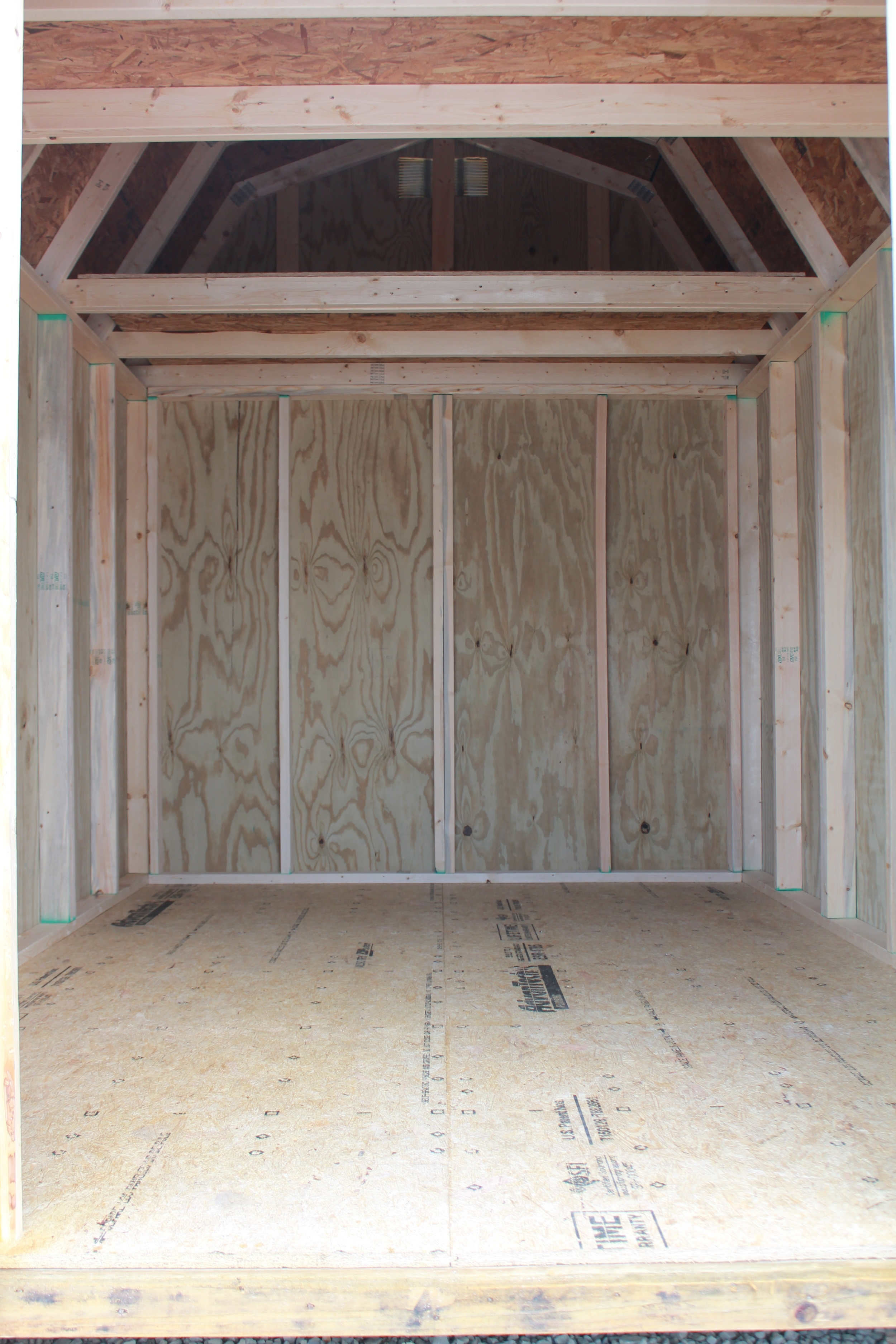 pressure treated lofted barn with metal roof delivered to customer.JPG